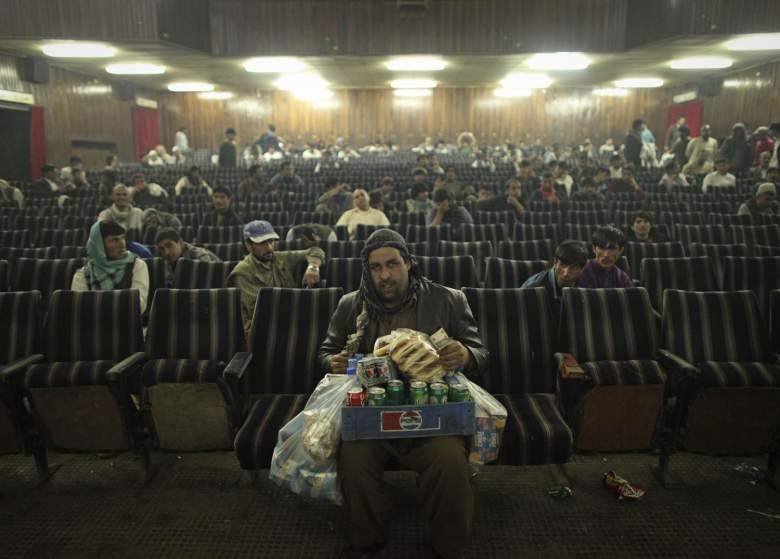 An employee of Cinema Pamir sells refreshments during the movie interval in Kabul